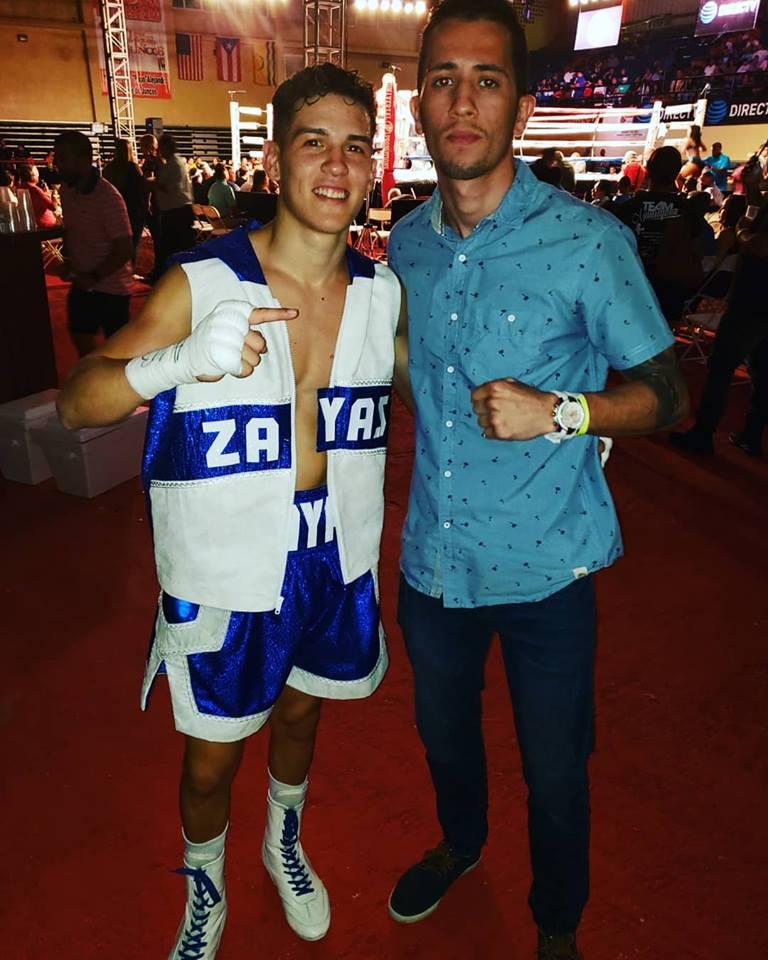 Juan Zayas junto al joven boxeador de Bayamon Bryan Chary Chevalier