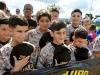 Jóvenes peloteros durante el himno