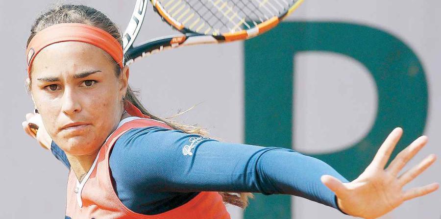 Mónica Puig jugando en un partido de Tenis