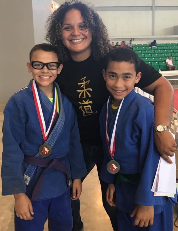 Carlos Aviles, la atleta olimpica Melissa Mojica y Jetxiel Colon